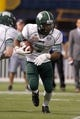 Dec 23, 2013; St. Petersburg, FL, USA; Ohio Bobcats running back Daz'mond Patterson (7) runs with the ball against the East Carolina Pirates during the second quarter at the 2013 Beef O Bradys Bowl at Tropicana Field. Mandatory Credit: Kim Klement-USA TODAY Sports