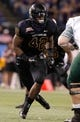 Dec 23, 2013; St. Petersburg, FL, USA; East Carolina Pirates linebacker Gabe Woullard (42) rushes against the Ohio Bobcats during the second half at the 2013 Beef O Bradys Bowl at Tropicana Field. East Carolina Pirates defeated the Ohio Bobcats 37-20. Mandatory Credit: Kim Klement-USA TODAY Sports