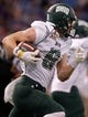 Dec 23, 2013; St. Petersburg, FL, USA; Ohio Bobcats wide receiver Chase Cochran (8) runs with the ball against the East Carolina Pirates during the second half at the 2013 Beef O Bradys Bowl at Tropicana Field. East Carolina Pirates defeated the Ohio Bobcats 37-20. Mandatory Credit: Kim Klement-USA TODAY Sports