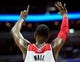 Jan 18, 2014; Washington, DC, USA; Washington Wizards guard John Wall (2) signals to teammates in the second quarter against the Detroit Pistons at Verizon Center. Mandatory Credit: Evan Habeeb-USA TODAY Sports