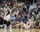 Jan 18, 2014; Chicago, IL, USA; Philadelphia 76ers shooting guard James Anderson (9) and Chicago Bulls small forward Mike Dunleavy (34) go for a loose ball during the first quarter at the United Center. Mandatory Credit: David Banks-USA TODAY Sports