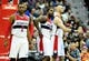 Jan 18, 2014; Washington, DC, USA; Washington Wizards guard John Wall (2) forward Martell Webster and center Marcin Gortat (4) react after a foul in the game against the Detroit Pistons at Verizon Center. Mandatory Credit: Evan Habeeb-USA TODAY Sports