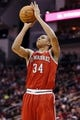 Jan 18, 2014; Houston, TX, USA; Milwaukee Bucks guard Giannis Antetokounmpo (34) shoots during the second half against the Houston Rockets at Toyota Center. The Rockets won 114-104. Mandatory Credit: Soobum Im-USA TODAY Sports