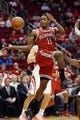 Jan 18, 2014; Houston, TX, USA; Milwaukee Bucks guard Brandon Knight (11) passes the ball under the basket during the second half against the Houston Rockets at Toyota Center. The Rockets won 114-104. Mandatory Credit: Soobum Im-USA TODAY Sports