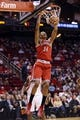 Jan 18, 2014; Houston, TX, USA; Milwaukee Bucks guard Giannis Antetokounmpo (34) dunks during the second half against the Houston Rockets at Toyota Center. The Rockets won 114-104. Mandatory Credit: Soobum Im-USA TODAY Sports