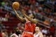 Jan 18, 2014; Houston, TX, USA; Milwaukee Bucks guard Brandon Knight (11) drives to the basket past Houston Rockets guard James Harden (left) during the second half at Toyota Center. The Rockets won 114-104. Mandatory Credit: Soobum Im-USA TODAY Sports