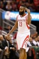 Jan 18, 2014; Houston, TX, USA; Houston Rockets guard James Harden (13) reacts after a shot during the second half against the Milwaukee Bucks at Toyota Center. The Rockets won 114-104. Mandatory Credit: Soobum Im-USA TODAY Sports