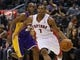 Jan 19, 2014; Toronto, Ontario, CAN; Toronto Raptors guard Kyle Lowry (7) carries the ball past Los Angeles Lakers guard Jodie Meeks (20) during the first half at the Air Canada Centre. Mandatory Credit: John E. Sokolowski-USA TODAY Sports