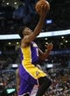 Jan 19, 2014; Toronto, Ontario, CAN; Los Angeles Lakers forward-guard Nick Young (0) goes up to make a basket against the Toronto Raptors at the Air Canada Centre. Los Angeles defeated Toronto 112-106. Mandatory Credit: John E. Sokolowski-USA TODAY Sports