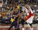 Jan 19, 2014; Toronto, Ontario, CAN; Los Angeles Lakers forward-guard Nick Young (0) tries to carry the ball past Toronto Raptors guard Julyan Stone (77) defends at the Air Canada Centre. Los Angeles defeated Toronto 112-106. Mandatory Credit: John E. Sokolowski-USA TODAY Sports