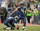 Sep 22, 2013; Seattle, WA, USA; Seattle Seahawks kicker Steven Haushka (4) attempts an extra point out of the hold of Jon Ryan (9) against the Jacksonville Jaguars at CenturyLink Field. The Seahawks defeated the Jaguars 45-17. Mandatory Credit: Kirby Lee-USA TODAY Sports