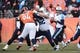 Dec 8, 2013; Denver, CO, USA;Tennessee Titans quarterback Ryan Fitzpatrick (4) prepares to pass in the second quarter against the Denver Broncos at Sports Authority Field at Mile High. Mandatory Credit: Ron Chenoy-USA TODAY Sports