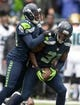 Sep 22, 2013; Seattle, WA, USA; Seattle Seahawks safety Kam Chancellor (31) celebrates with cornerback Byron Maxwell (41) after intercepting a pass in the fourth quarter against the Jacksonville Jaguars at CenturyLink Field. The Seahawks defeated the Jaguars 45-17. Mandatory Credit: Kirby Lee-USA TODAY Sports
