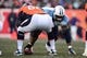 Dec 8, 2013; Denver, CO, USA; Tennessee Titans defensive tackle Sammie Lee Hill (94) lines up in front of Denver Broncos center Steve Vallos (60) in the second quarter at Sports Authority Field at Mile High. Mandatory Credit: Ron Chenoy-USA TODAY Sports