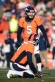 Dec 8, 2013; Denver, CO, USA; Denver Broncos kicker Matt Prater (5) in the second quarter against the Tennessee Titans at Sports Authority Field at Mile High. Mandatory Credit: Ron Chenoy-USA TODAY Sports