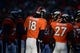 Dec 8, 2013; Denver, CO, USA; Denver Broncos quarterback Peyton Manning (18) and running back Knowshon Moreno (27) huddle in the second quarter against the Tennessee Titans at Sports Authority Field at Mile High. Mandatory Credit: Ron Chenoy-USA TODAY Sports
