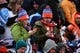Dec 8, 2013; Denver, CO, USA; Denver Broncos fans on their cell phones in the second quarter against the Tennessee Titans at Sports Authority Field at Mile High. Mandatory Credit: Ron Chenoy-USA TODAY Sports