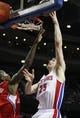 Jan 20, 2014; Auburn Hills, MI, USA; Detroit Pistons small forward Kyle Singler (25) takes a shot over Los Angeles Clippers shooting guard Jamal Crawford (11) during the third quarter at The Palace of Auburn Hills. Clippers beat the Pistons 112-103. Mandatory Credit: Raj Mehta-USA TODAY Sports