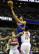 Jan 20, 2014; Washington, DC, USA; Philadelphia 76ers point guard Michael Carter-Williams (1) shoots over Washington Wizards shooting guard Garrett Temple (17) during the second half at Verizon Center. The Wizards defeated the 76ers 107 - 99. Mandatory Credit: Brad Mills-USA TODAY Sports