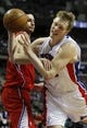 Jan 20, 2014; Auburn Hills, MI, USA; Detroit Pistons small forward Kyle Singler (25) gets fouled by Los Angeles Clippers shooting guard J.J. Redick (4) during the fourth quarter at The Palace of Auburn Hills. Clippers beat the Pistons 112-103. Mandatory Credit: Raj Mehta-USA TODAY Sports