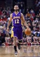 Jan 20, 2014; Chicago, IL, USA; Los Angeles Lakers point guard Kendall Marshall (12) dribbles the ball against the Chicago Bulls during the first half at United Center. Mandatory Credit: Mike DiNovo-USA TODAY Sports