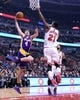 Jan 20, 2014; Chicago, IL, USA; Los Angeles Lakers power forward Ryan Kelly (4) shoots the ball against Chicago Bulls shooting guard Jimmy Butler (21) during the first half at United Center. Mandatory Credit: Mike DiNovo-USA TODAY Sports
