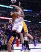 Jan 20, 2014; Chicago, IL, USA; Chicago Bulls shooting guard Jimmy Butler (21) shoots the ball against Los Angeles Lakers power forward Ryan Kelly (4) during the second half at United Center. The Bulls defeat the Lakers 102-100 in overtime. Mandatory Credit: Mike DiNovo-USA TODAY Sports