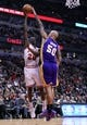 Jan 20, 2014; Chicago, IL, USA; Chicago Bulls shooting guard Tony Snell (20) shoots the ball against Los Angeles Lakers center Robert Sacre (50) during the second half at United Center. The Bulls defeat the Lakers 102-100 in overtime. Mandatory Credit: Mike DiNovo-USA TODAY Sports