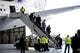 Jan 26, 2014; Newark, NJ, USA; The Denver Broncos arrive at Newark Liberty International Airport to face the Seattle Seahawks in Super Bowl XLVIII . Mandatory Credit: Joe Camporeale-USA TODAY Sports