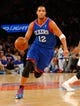 Jan 22, 2014; New York, NY, USA;  Philadelphia 76ers small forward Evan Turner (12) brings the ball up court during the first half against the New York Knicks at Madison Square Garden. Mandatory Credit: Jim O'Connor-USA TODAY Sports