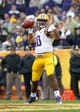 Jan 1, 2014; Tampa, Fl, USA; LSU Tigers quarterback Anthony Jennings (10) throws the ball against the Iowa Hawkeyes during the first half at Raymond James Stadium. Mandatory Credit: Kim Klement-USA TODAY Sports