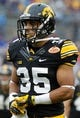 Jan 1, 2014; Tampa, Fl, USA; Iowa Hawkeyes defensive back Gavin Smith (35) against the LSU Tigers during the first half at Raymond James Stadium. Mandatory Credit: Kim Klement-USA TODAY Sports