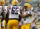 Jan 1, 2014; Tampa, Fl, USA; LSU Tigers quarterback Anthony Jennings (10) calls a play against the Iowa Hawkeyes during the first half at Raymond James Stadium. Mandatory Credit: Kim Klement-USA TODAY Sports