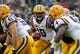 Jan 1, 2014; Tampa, Fl, USA; LSU Tigers quarterback Anthony Jennings (10) hands the ball off against the Iowa Hawkeyes during the first half at Raymond James Stadium. Mandatory Credit: Kim Klement-USA TODAY Sports