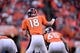January 19, 2014; Denver, CO, USA; Denver Broncos quarterback Peyton Manning (18) audibles in the first of the game against the New England Patriots of the 2013 AFC Championship football game at Sports Authority Field at Mile High. Mandatory Credit: Ron Chenoy-USA TODAY Sports