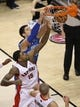 Jan 29, 2014; Toronto, Ontario, CAN; Orlando Magic center Nikola Vucevic (9) dunks against the Toronto Raptors center Amir Johnson (15) at Air Canada Centre. Mandatory Credit: Tom Szczerbowski-USA TODAY Sports