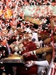 Jan 2, 2014; New Orleans, LA, USA; Oklahoma Sooners coach Bob Stoops celebrates with the Sugar Bowl trophy and his players at the Mercedes-Benz Superdome. Oklahoma beat the Alabama Crimson Tide, 45-31. Mandatory Credit: Chuck Cook-USA TODAY Sports