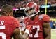 Jan 2, 2014; New Orleans, LA, USA; Alabama Crimson Tide running back Derrick Henry (27), right, talks to teammate Jalston Fowler (45) during the Sugar Bowl at the Mercedes-Benz Superdome. Oklahoma won, 45-31. Mandatory Credit: Chuck Cook-USA TODAY Sports