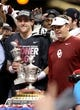 Jan 2, 2014; New Orleans, LA, USA; Oklahoma Sooners quarterback Trevor Knight, with the MVP trophy, and head coach Bob Stoops celebrate at the end of the Sugar Bowl at the Mercedes-Benz Superdome. Oklahoma beat the Alabama Crimson Tide, 45-31. Mandatory Credit: Chuck Cook-USA TODAY Sports