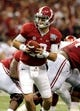 Jan 2, 2014; New Orleans, LA, USA; Alabama Crimson Tide quarterback AJ McCarron (10) looks to hand the ball off against the Oklahoma Sooners during the second half of the Sugar Bowl at the Mercedes-Benz Superdome. Oklahoma won, 45-31. Mandatory Credit: Chuck Cook-USA TODAY Sports