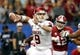 Jan 2, 2014; New Orleans, LA, USA; Oklahoma Sooners quarterback Trevor Knight (9) looks to throw a pass against the Alabama Crimson Tide during the second half of the Sugar Bowl at the Mercedes-Benz Superdome. Mandatory Credit: Chuck Cook-USA TODAY Sports