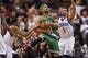 Feb 5, 2014; Philadelphia, PA, USA; Philadelphia 76ers guard Evan Turner (12) battles for the ball with Boston Celtics guard Jerryd Bayless (11) during the fourth quarter at the Wells Fargo Center. The Celtics defeated the Sixers 114-108. Mandatory Credit: Howard Smith-USA TODAY Sports