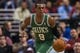 Feb 5, 2014; Philadelphia, PA, USA; Boston Celtics guard Rajon Rondo (9) brings the ball up court during the third quarter against the Philadelphia 76ers at the Wells Fargo Center. The Celtics defeated the Sixers 114-108. Mandatory Credit: Howard Smith-USA TODAY Sports