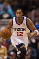 Feb 5, 2014; Philadelphia, PA, USA; Philadelphia 76ers guard Evan Turner (12) brings the ball up court during the fourth quarter against the Boston Celtics at the Wells Fargo Center. The Celtics defeated the Sixers 114-108. Mandatory Credit: Howard Smith-USA TODAY Sports