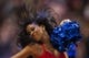 Feb 5, 2014; Philadelphia, PA, USA; A Philadelphia 76ers dream team dancer performs during the fourth quarter against the Boston Celtics at the Wells Fargo Center. The Celtics defeated the Sixers 114-108. Mandatory Credit: Howard Smith-USA TODAY Sports