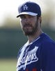 Feb 9, 2014; Glendale, AZ, USA; Los Angeles Dodgers pitcher Dan Haren (14) looks on during the first day of camp at Camelback Ranch. Mandatory Credit: Rick Scuteri-USA TODAY Sports