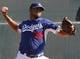 Feb 9, 2014; Glendale, AZ, USA; Los Angeles Dodgers relief pitcher Kenley Jansen (74) throws the ball during the first day of camp at Camelback Ranch. Mandatory Credit: Rick Scuteri-USA TODAY Sports