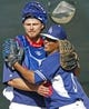Feb 9, 2014; Glendale, AZ, USA; Los Angeles Dodgers catcher Griff Erickson (79) and pitcher Jose Dominguez (60) hug during the first day of camp at Camelback Ranch. Mandatory Credit: Rick Scuteri-USA TODAY Sports