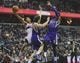 Feb 9, 2014; Washington, DC, USA; Washington Wizards shooting guard Garrett Temple (17) is fouled by Sacramento Kings point guard Jimmer Fredette (7) as Sacramento Kings shooting guard Ben McLemore (16) looks on during the first half at Verizon Center. Mandatory Credit: Brad Mills-USA TODAY Sports