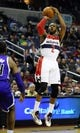 Feb 9, 2014; Washington, DC, USA; Washington Wizards point guard John Wall (2) shoots against the Sacramento Kings during the first half at Verizon Center. Mandatory Credit: Brad Mills-USA TODAY Sports